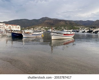 Port de la Selva, Cap de Creus, Girona, Spain July 2021: Traditional fishing boats mooring at Port de la Selva harbour
