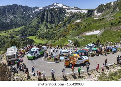 PORT DE PAILHERES,FRANCE- JUL 6: PMU vehicles during the passing of the publicity caravan on the road to the Col de Pailheres in the stage 8 of edition 100 of Le Tour de France on July 6 2013.