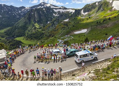 PORT DE PAILHERES,FRANCE- JUL 6:Official ambulance of the competition climbing the road to Col de Pailheres in Pyrenees Mountains during the stage 8 of Le Tour de France on 6 July 2013.