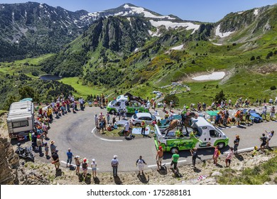PORT DE PAILHERES,FRANCE- JUL 6:PMU vehicles driving on the road to Col de Pailheres during the passing of the publicity caravan in the stage 8 of  Le Tour de France on July 6 2013.
