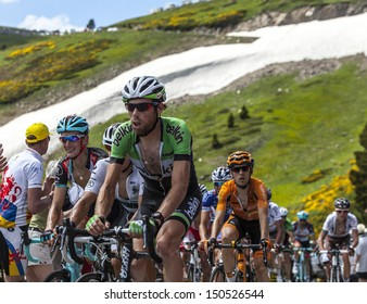 PORT DE PAILHERES,FRANCE- JUL 6:The peloton climbing the road to Col de Pailheres in Pyrenees Mountains during the stage 8 of the 100 edition of Le Tour de France on 6 July 2013.