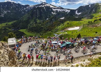 PORT DE PAILLERES,FRANCE- JUL 6: The peloton climbing the road to Col de Pailheres in Pyrenees Mountains during the stage 8 of the 100 edition of Le Tour de France on  July 6, 2013.
