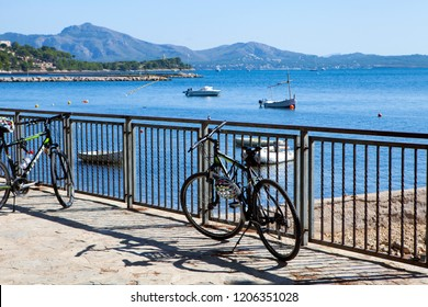 PORT DE POLLENCA, MAJORCA, SPAIN - September28th, 2018: Bicycles are parked by the seaside in Port de Pollenca, cycling is a popular sport in Majorca