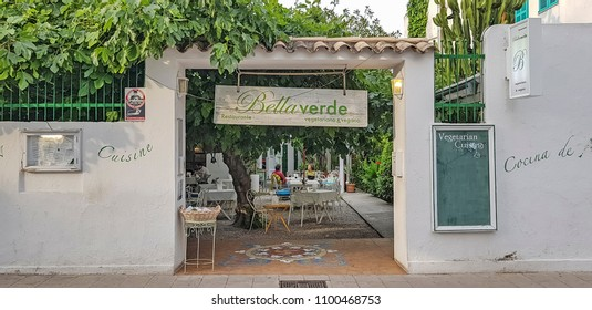 PORT DE POLLENSA, MALLORCA - MAY 20 2018: People eating in a restaurant. Port de Pollensa is a small town in northern Majorca, Spain, situated on the Bay of Pollensa.