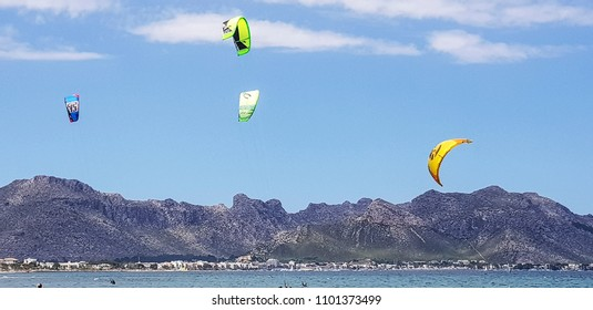 PORT DE POLLENSA, MALLORCA - MAY 24, 2018: Kite surfing in the Bay of Pollensa. Port de Pollensa is a small town in northern Majorca, Spain, situated on the Bay of Pollensa.