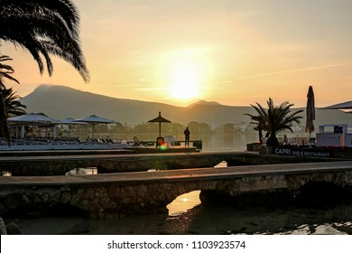 PORT DE POLLENSA, MALLORCA - MAY 20 2018: The Pier into the Bay of Pollensa  in the early morning. Port de Pollensa is a small town in northern Majorca, Spain, situated on the Bay of Pollensa.