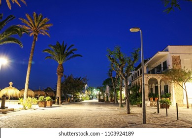 PORT DE POLLENSA, MALLORCA - MAY 20 2018: The promenade along the seafront in the early morning. Port de Pollensa is a small town in northern Majorca, Spain, situated on the Bay of Pollensa.