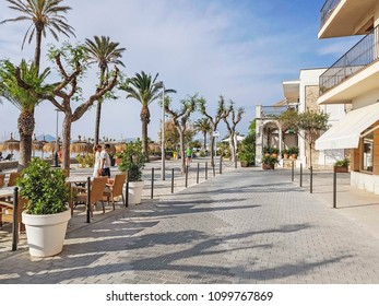PORT DE POLLENSA - MAY 20, 2018:  Promenade along seafront. Port de Pollensa is a small town in northern Majorca, Spain, situated on the Bay of Pollensa.