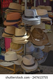 PORT DE SOLLER, MAJORCA, SPAIN - OCTOBER 25, 2013: Vacation straw hats on display on October 25, 2013 in Port de Soller, Majorca, Spain.