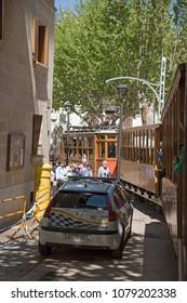 Port de Soller, Mallorca, Spain. April 2018. Vintage tram  in the narrow town centre of Port Soller.