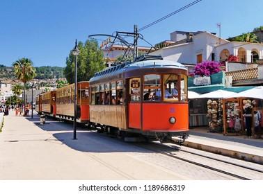 Port De Soller, Mallorca / Spain _ June 25 2018: Tram on the seafront at Port De Soller in Majorca Ballearic islands.