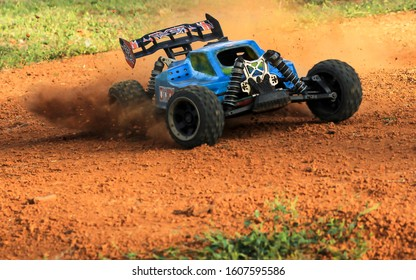 PORT DICKSON, MALAYSIA : Not in focus. Motion blur. Film grain. Noise. Blurred. RC Rock Crawler 4WD Off-road Race Truck Toy playing on the rugged track