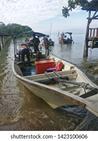 PORT DICKSON, MALAYSIA - NOV 28TH, 2018. Jiggers loading fishing equipment to the boat for slow pitch jigging at Malacca Strait.