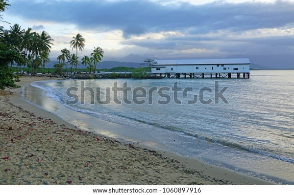 PORT DOUGLAS, AUSTRALIA -1 AUG 2017- View of the Sugar Wharf covered pier in Port Douglas on the Coral Sea in Far North Queensland, Australia, at sunset.
