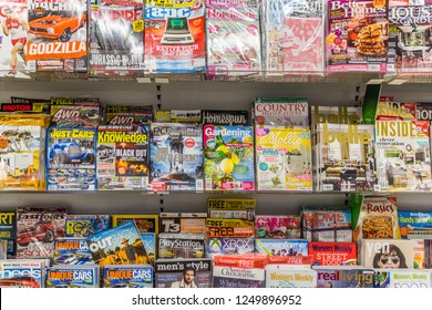 Port Douglas, Australia - 1st June 2015: Magazines on shelves for sale in Supermarket. A huge variety of subjects are covered.