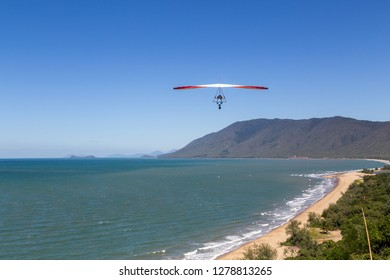 Port Douglas, Australia - April 27, 2015: A hang glider starting from Trinity Bay lookout