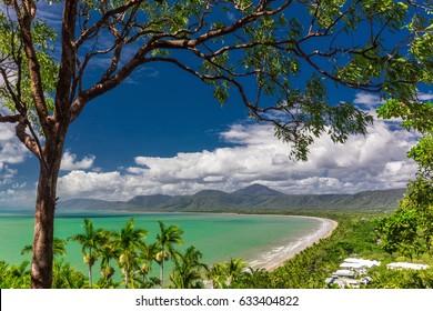 Port Douglas Four Mile Beach and ocean on sunny day, Queensland, Australia