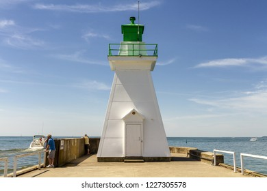 Port Dover, Ontario, Canada - June 17, 2018: Port Dover lighthouse in the entrance from Lake Erie.