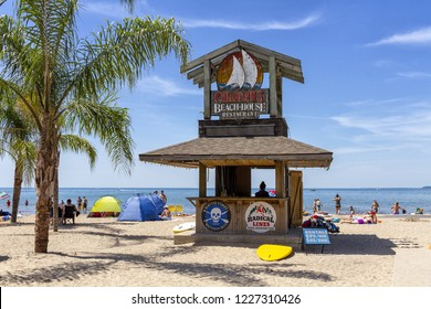 Port Dover, Ontario, Canada - June 17, 2018: Port Dover beach front in Lake Erie, during a typical sunny day.