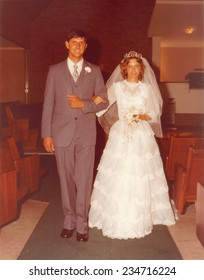PORT ELIZABETH, SOUTH AFRICA - 1970's: The newly wed couple walking down the isle