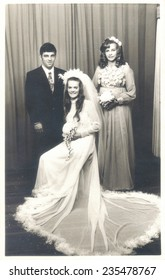 PORT ELIZABETH, SOUTH AFRICA - 1970's: The newly wed couple and their bridesmaid