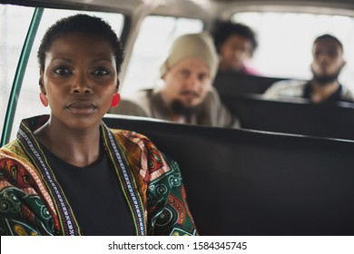 Port Elizabeth, South Africa April 2017 Multiracial group of people sitting in a taxi in South Africa