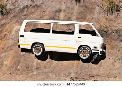Port Elizabeth, South Africa - August 12, 2019: Street art consisting of a sliced up white taxi which has been mounted onto a wall. This is a popular tourist attraction in the city (route 67).