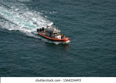 PORT EVERGLADES, FT. LAUDERDALE - March 17, 2019: United States Coast Guard boat patrols Port Everglades, Florida