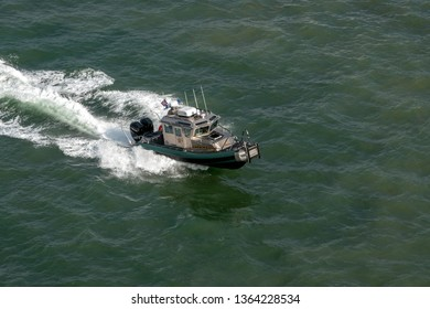 PORT EVERGLADES, FT. LAUDERDALE - March 17, 2019: Broward County Sheriff boat patrols Port Everglades, Florida