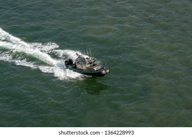 PORT EVERGLADES, FT. LAUDERDALE - March 17, 2019: Broward County Sheriff boat patrols Port Everglade, Florida