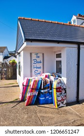 Port Eynon, Gower, UK: April 26, 2018: Gift store with pile of swimming accessories on the front.