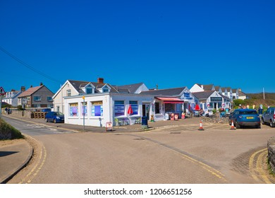 Port Eynon, Gower, UK: April 26, 2018: Locals and tourists are enjoying the sunny day at cafes near the beach.