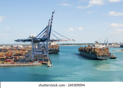 Port of Freeport Bahamas Container shipyard with heavy lifting Cranes and a ship waiting to off load its cargo