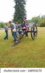 PORT GAMBLE, WA - JUN 20  - Civil War reenactors participate in a mock battle on Jun 20, 2009. Confederate artillery preparing their guns.