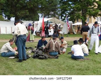 PORT GAMBLE, WA - JUN 20  - Civil War reenactors participate in a mock battle on Jun 20, 2009. Union infantry in camp before battle, at mealtime.