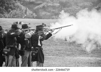 PORT GAMBLE, WA - JUN 20  -   Union infantry skirmishers hold their position during a mock Civil War battle  on Jun 20, 2009 in Port Gamble WA