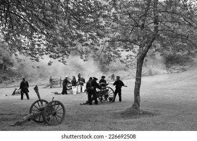 PORT GAMBLE, WA - JUN 20 2009: Civil War reenactors participate in a mock battle. Artillery fired by Union naval shore party,