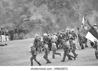 PORT GAMBLE, WA - JUN 20  -  Confederate infantry reinforces their line during a mock Civil War battle on Jun 20, 2009 in Port Gamble WA