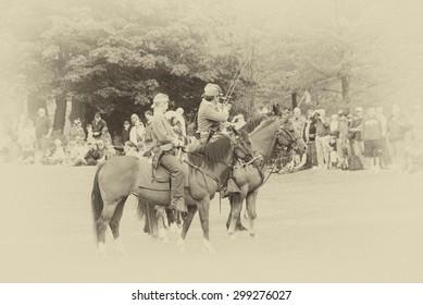 PORT GAMBLE, WA - JUN 20: Civil War reenactors participate in a mock battle. Union and Confederate cavalry maneuvering in open field. on Jun 20, 2009, in Port Gamble, WA.