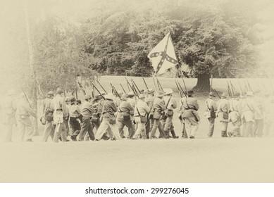 PORT GAMBLE, WA - JUN 20 2009: Confederate troops marching in column formation,   Civil War Battle Re-enactment,  Port Gamble, WA