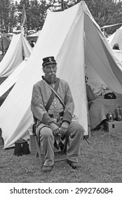 PORT GAMBLE, WA - JUN 20  - A Confederate sergeant waits by his tent before battle, during a Civil War Battle Re-enactment, on Jun 20, 2009 in Port Gamble, WA.