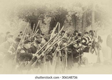 PORT GAMBLE, WA - JUN 20, 2009  - Civil War reenactors participate in a mock battle on Jun 20, 2009. Union infantry line firing a volley,  Civil War Battle Re-enactment,  Port Gamble, WA