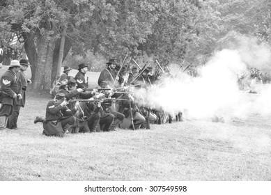 PORT GAMBLE, WA - JUN 20  - Union infantry fire a volley during a mock Civil War battle at Port Gamble WA on Jun 20, 2009.