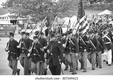 PORT GAMBLE, WA - JUN 20: Civil War reenactors participate in a mock battle. Union army marching to battle in column formation.