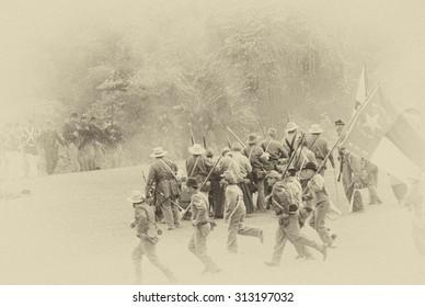 PORT GAMBLE, WA - JUN 20  -  Confederate infantry reinforces their line during a mock Civil War battle on Jun 20, 2009in Port Gamble WA