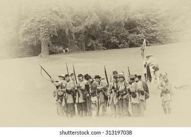 PORT GAMBLE, WA - JUN 20  - Civil War reenactors participate in a mock battle on Jun 20, 2009. Confederate infantry line firing a volley.
