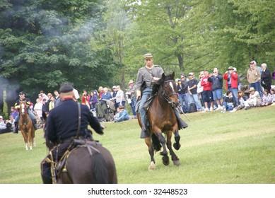 PORT GAMBLE, WA - JUN 20:  Cavalry skirmishing in open field in civil war battle re-enactment in Port Gamble, WA on June 20, 2009.