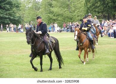 PORT GAMBLE, WA - JUN 20: Civil War reenactors participate in a mock battle. Union and Confederate cavalry maneuvering in open field.