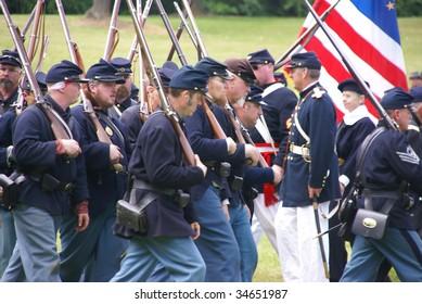 PORT GAMBLE, WA - JUN 20  - Civil War reenactors participate in a mock battle on Jun 20, 2009  in Port Gamble, Washington.. Union army marching to battle in column formation.