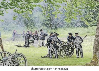 PORT GAMBLE, WA - JUN 20: Civil War reenactors participate in a mock battle. Artillery fired by Union naval shore party,